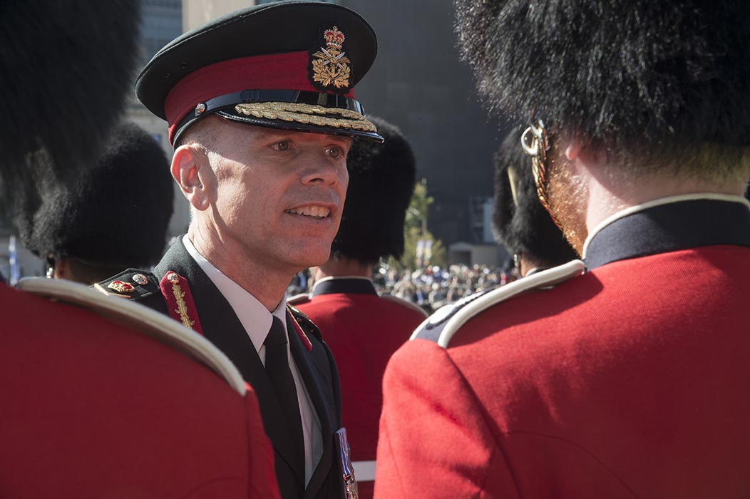 Lieutenant-General Wayne Eyre, Commander Canadian Army, speaks with a member of the Ceremonial Guard during the Canadian Army Change of Command ceremony on Parliament Hill in Ottawa, Ontario on August 20, 2019. Photo: Sergeant Lance Wade, 5th Canadian Division. ©2019 DND/MDN Canada.