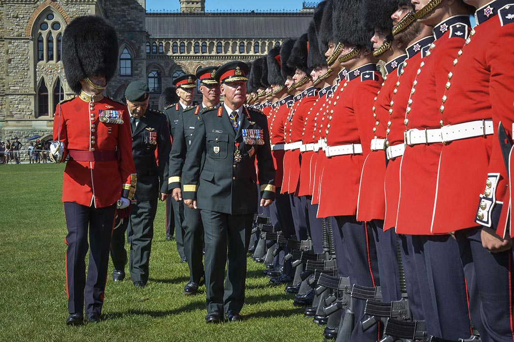General Johnathan Vance, Canadian Chief of Defense Staff, Lieutenant- General Jean-Marc Lanthier, outgoing Commander of the Canadian Army, Lieutenant- General Wayne Eyre, incoming Commander of the Canadian Army, inspect the Ceremonial Guard during the Canadian Army Change of Command ceremony on Parliament Hill in Ottawa, Ontario on August 20, 2019. Photo: Sergeant Lance Wade, 5th Canadian Division. ©2019 DND/MDN Canada.