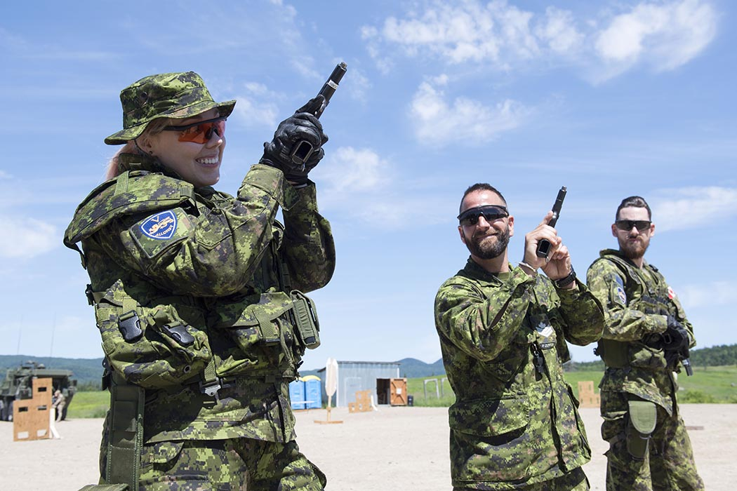 "Video game champion ""missharvey"" tests reality on July 18, 2019 at 2nd Canadian Division Support Base Valcartier in Quebec with members of 1st Battalion, Royal 22e Régiment.  Photo: Private Marc-André Leclerc, Valcartier Imagery. ©2019 DND / DND Canada."