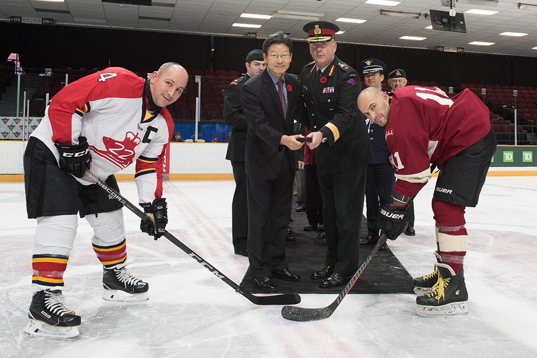 Korean Ambassador Maeng-ho Shin (L) and Canadian Army Representative Brigadier-General S. Kelsey (R) drop the puck to start the annual re-enactment of the Imjin Classic hockey game, on November 3, 2018 at TD Place, Ottawa, Ontario. Photo: Sergeant Dwayne Janes, Army Public Affairs. ©2018 DND/MDN Canada.