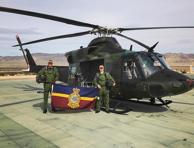 Sergeant Brigitte O'Driscoll and Sergeant Chris Lamb, who are both members of the Royal Montreal Regiment, during their Door Gunner training at the U.S. Marine Corps' Air Ground Command Center in Twentynine Palms, California. Photo: Provided by Sergeant Brigitte O'Driscoll.