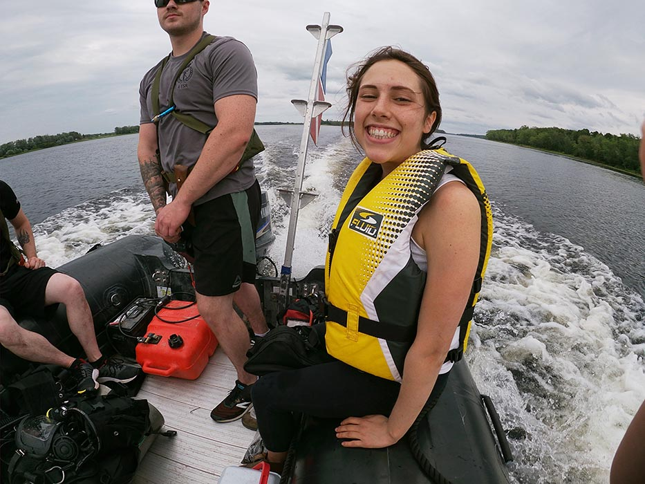 Mount Allison University research assistant Amber LeBlanc is very happy to have the Canadian Army Dive Team assist with a microplastics study on August 8, 2019 near Oromocto, New Brunswick.  Photo: Casey Doucet, Mount Allison University.
