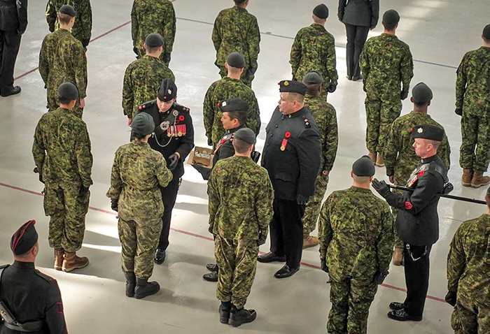 New members of The Queen's Own Rifles of Canada, a Toronto-based Army Reserve regiment, are given Coins of Remembrance to mark Remembrance Day.