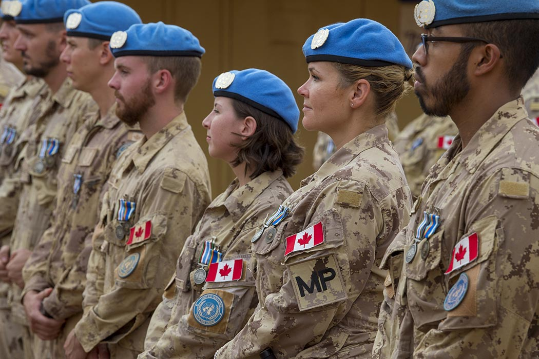 Members of Task Force-Mali stand easy during the Operation PRESENCE-Mali medals parade at Camp Castor on June 8, 2019.  Photo: Corporal François Charest, 430 Tactical Helicopter Squadron. ©2019 DND/MDN Canada. TM02-2019-0076-0010.
