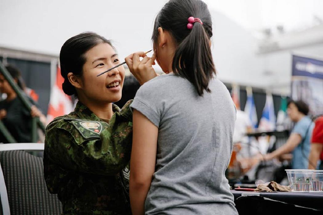 Sergeant Amelia Chia takes part in Canada Day 2019 festivities in her home community of Surrey, British Columbia. Sgt Chia is currently serving in Kuwait as part of Operation IMPACT. Photo: Bombardier Albert Law, 39 CBG Public Affairs. ©2019 DND/MDN Canada.