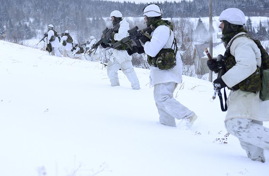 Members of 3rd Battalion, Royal 22e Régiment wear the Canadian Army's Winter Operations while on Exercise RAFALE BLANCHE in Saint-Sylvestre, Québec on February 5, 2014. Photo: Master Corporal Patrick Blanchard, Canadian Forces Combat Camera. ©2014 DND/MDN Canada.