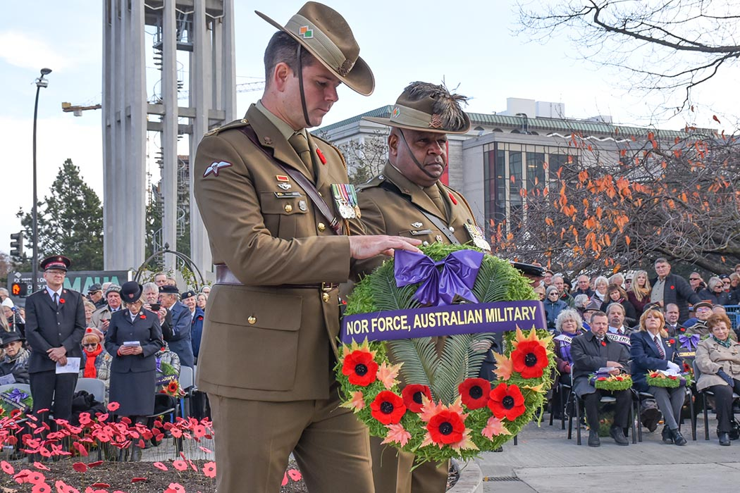 Major James Oliver (left), and Warrant Officer Class One Kenneth Nelliman (right) of Australia's North-West Mobile Force (NORFORCE) lay a wreath at the Provincial Cenotaph during the Remembrance Day Service held at the British Columbia Legislature building in Victoria on November 11, 2019. The event was just one part of Exercise Northern Lights. Photo: Lieutenant Natasha Tersigni. ©2019 DND/MDN Canada.