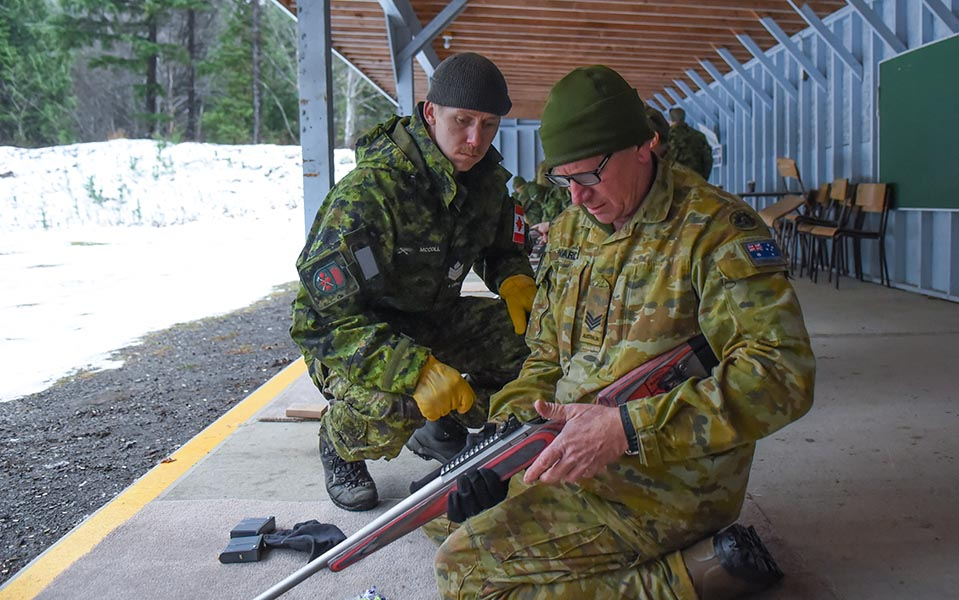 Sergeant Kirk McColl, a Canadian Ranger Instructor of the 4th Canadian Ranger Patrol Group (left) runs through C19 service rifle drills with North-West Mobile Force (NORFORCE) Centre Squadron Sergeant Martin Edwards. Photo: Lieutenant Natasha Tersigni. ©2019 DND/MDN Canada.