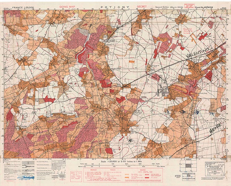 Going over map of Potigny, France. Photo provided by Canadian Research and Mapping Association