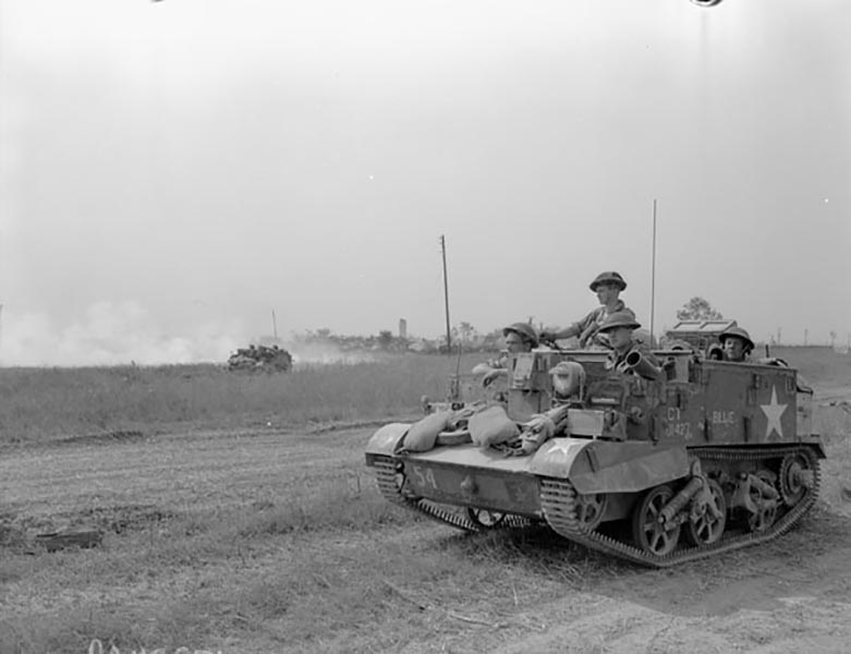 """Corporal Charles Byce landed in Normandy with the Lake Superior Regiment in late July, 1944. His unit served as the 4th Canadian Armoured Brigade's motorized infantry battalion. To keep up with the tanks, he and his fellow soldiers travelled in trucks and light armoured, tracked vehicles known as universal carriers. They saw their first fighting on the Caen-Falaise road in August, 1944, and played a role in closing the Falaise Gap, an escape route for encircled German troops in Normandy."" Photo provided by Canadian Research and Mapping Association"