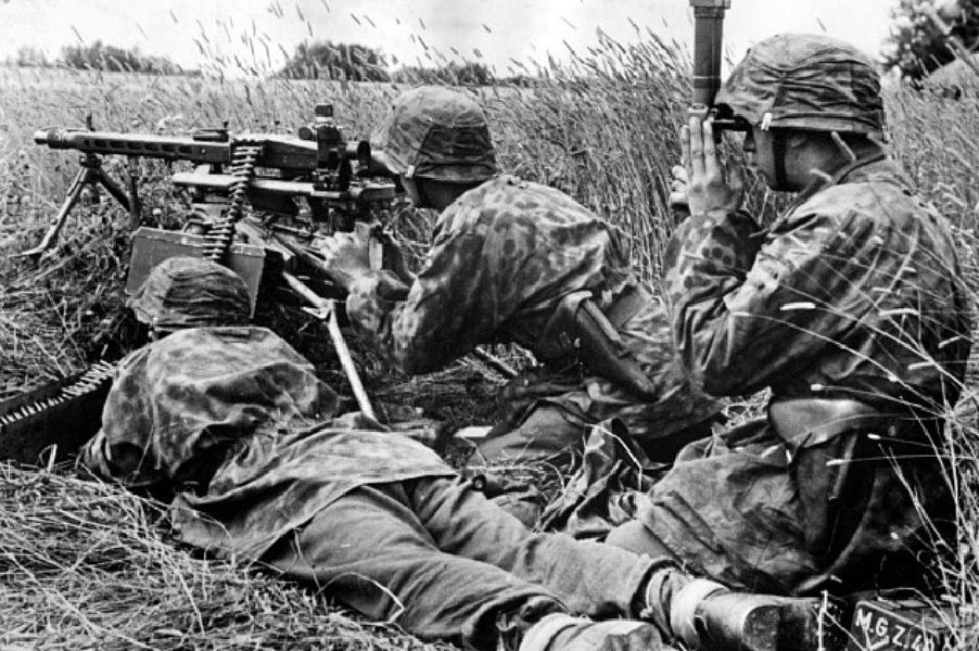"""The SDG patrol was situated on top of the high feature, where the ground is flat, and the Germans' line of sight clear. Frantically untying each other while under fire, the patrol answers the ambush with a volley of bren gun fire and grenades. During this furious exchange, Lt Williams and L/Cpl George Pollard are wounded, and one Sapper is killed. Laying in the grass bleeding, Lt Williams yells, 'Carry on Corporal and give them hell!'"" Photo provided by Canadian Research and Mapping Association"