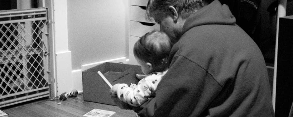 Slide - Master Corporal Byron Hardy reading to his grandson, JJ