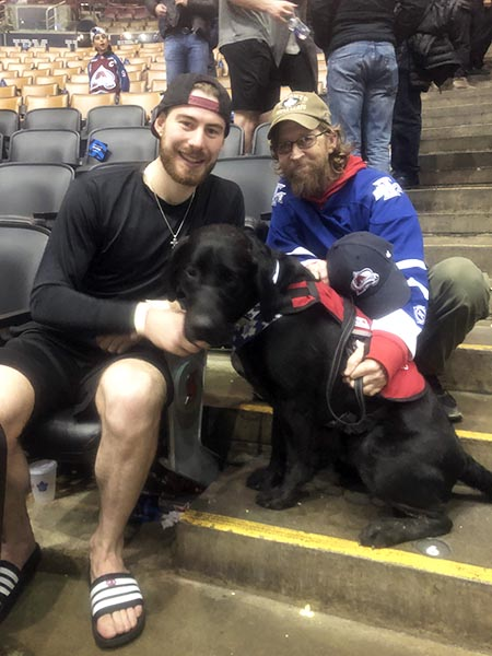"Leafs fan Sergeant (Retired) Kevin Barter, Thunder and Colorado Avalanche goalie, Philipp Grubauer, December 4, 2019, Scotiabank Arena, Toronto. ""The Leafs got smoked. Grubauer had a shut-out and was the first star of the game. My buddy Neil knew a family member and set up the meeting after the game for us."" Photo by Neil Washer"