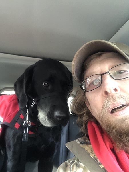 Sergeant (Retired) Kevin Barter and his PTSD service dog, Thunder.