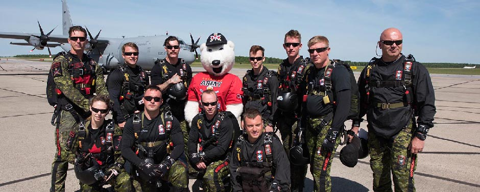 Slide - Juno the Canadian Army Mascot and the SkyHawks.