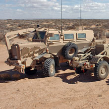 Two Husky vehicles and a Buffalo vehicle (left).
